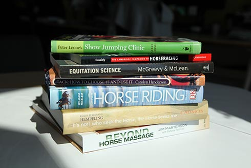pile of horse litertarure books